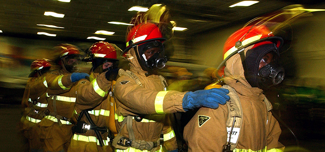 fire fighters supporting each other